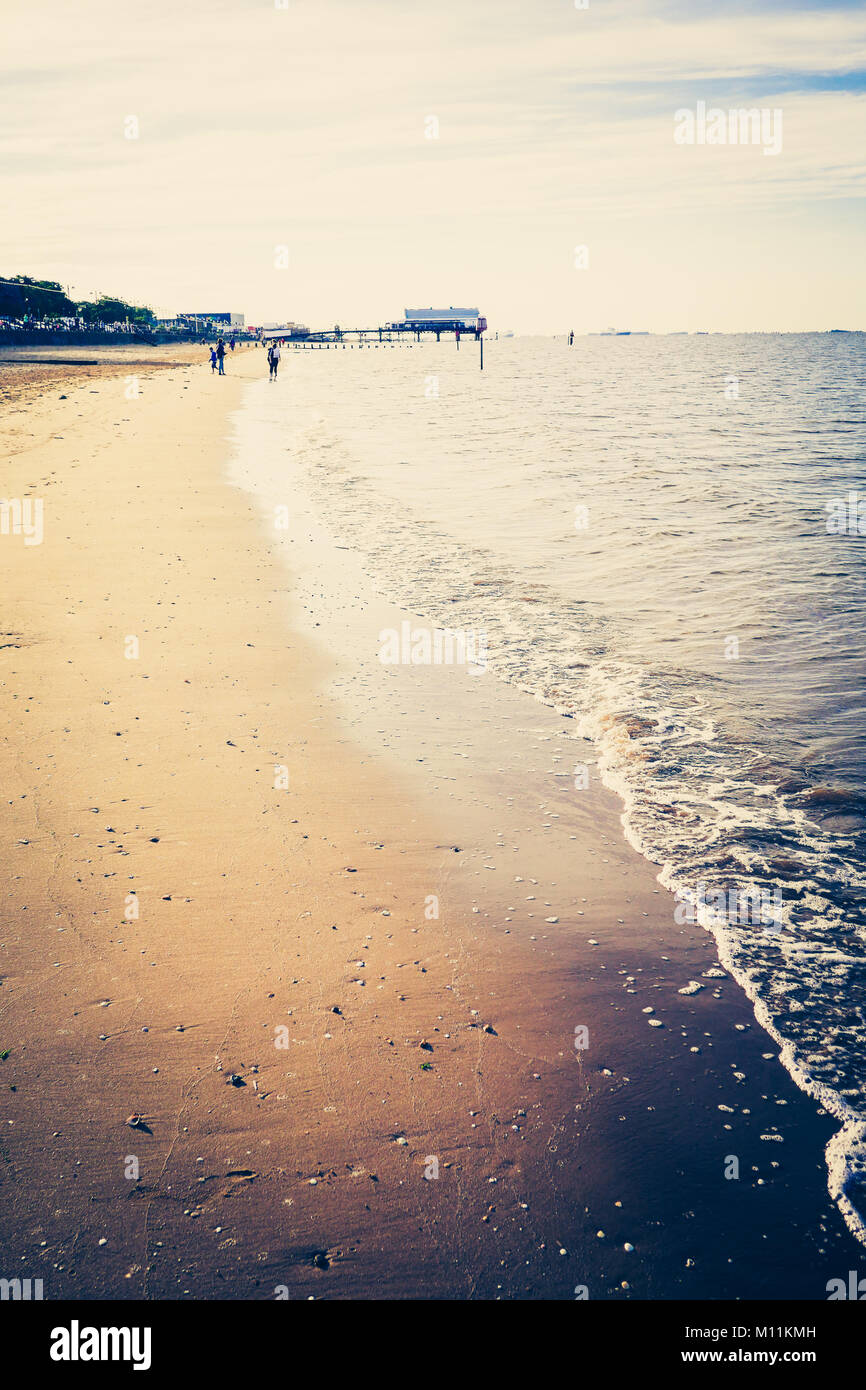 Sea gently lapping against sandy beach at Cleethorpes England, UK - Stock Image