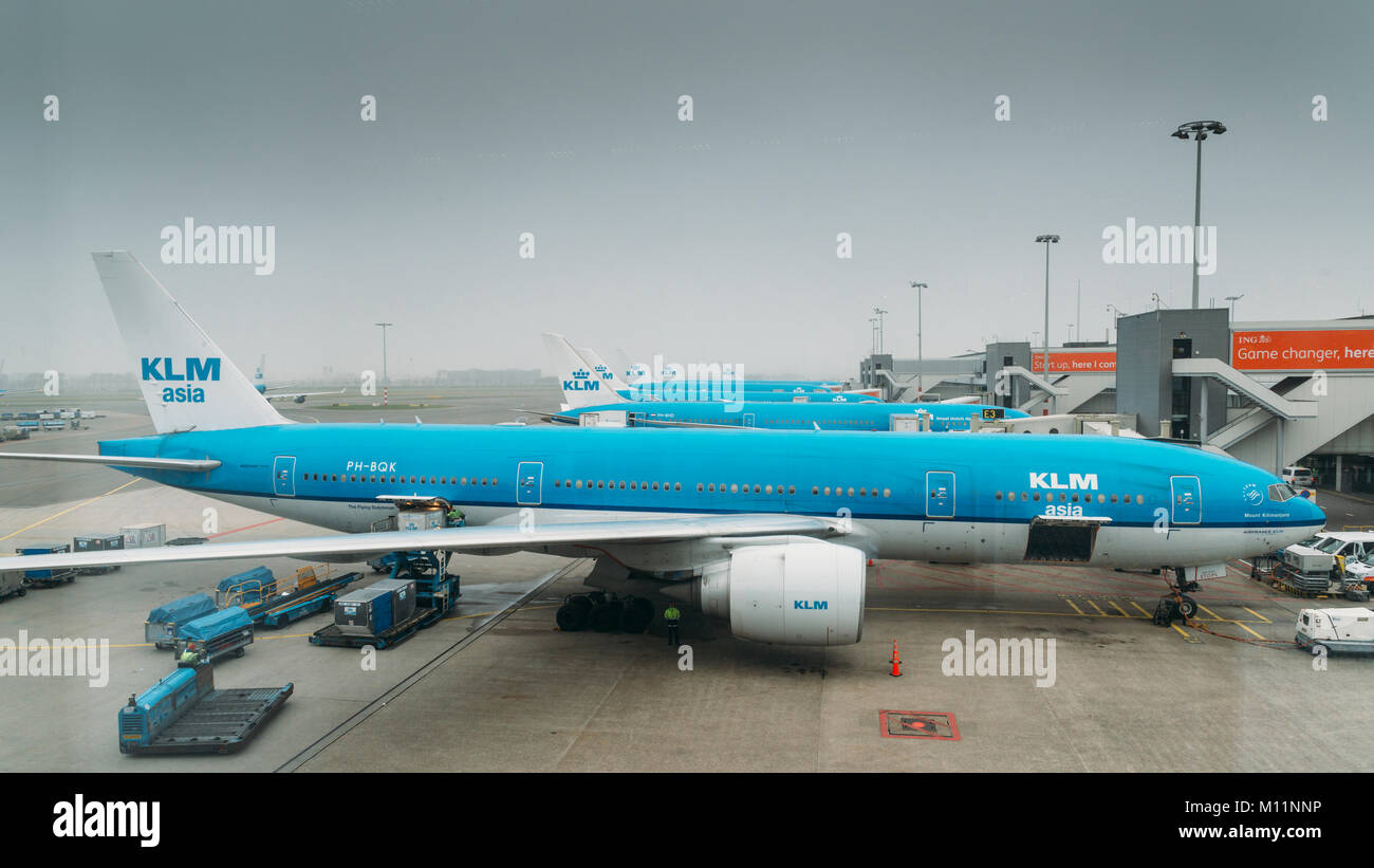 Boeing 777-206 KLM airplanes on tarmac at Schiphol Airport in Amsterdam, Netherlands. KLM is the flag-carrier airliner - Stock Image