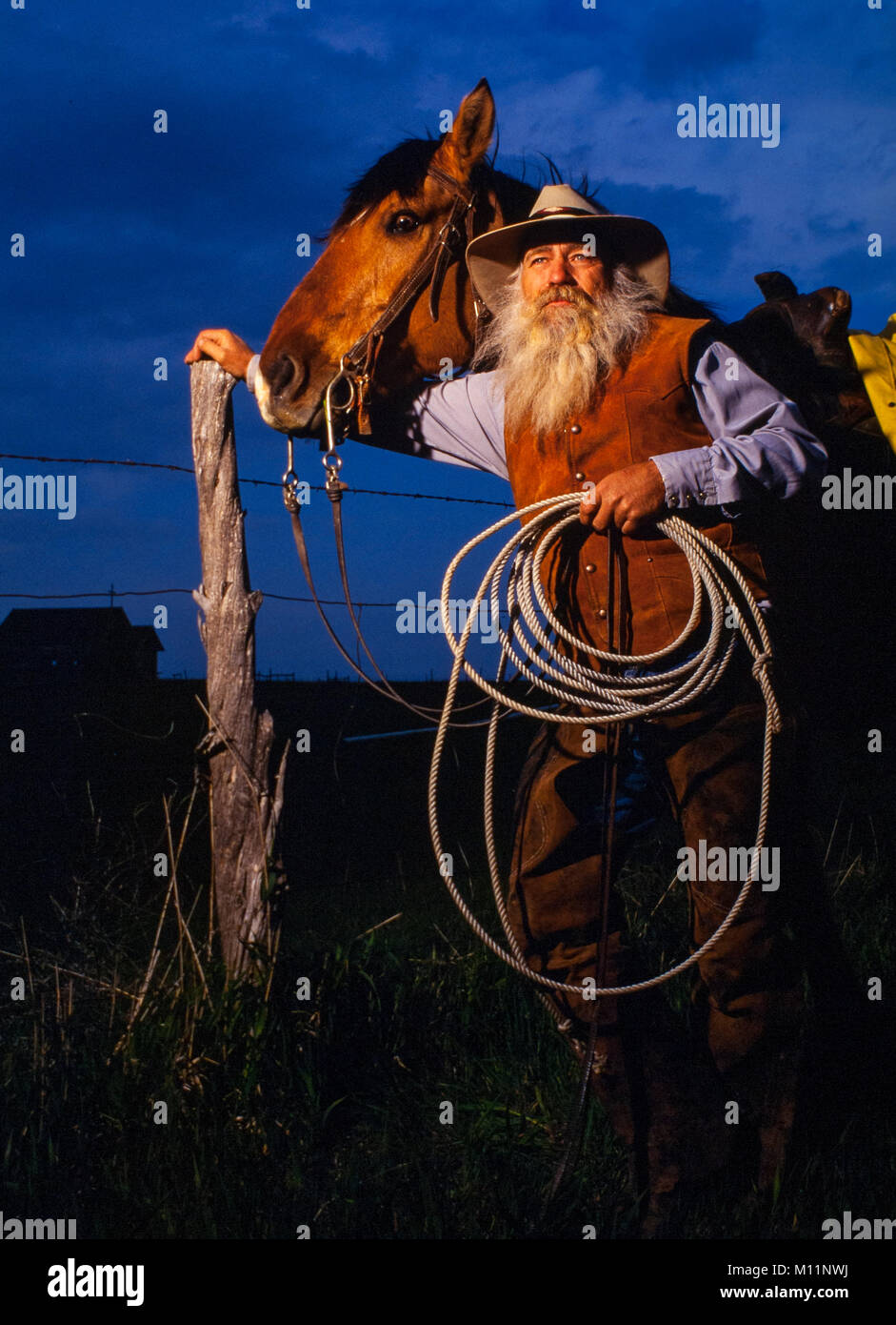 Rancher Dale Buxcel and his horse on the South Dakota range. - Stock Image