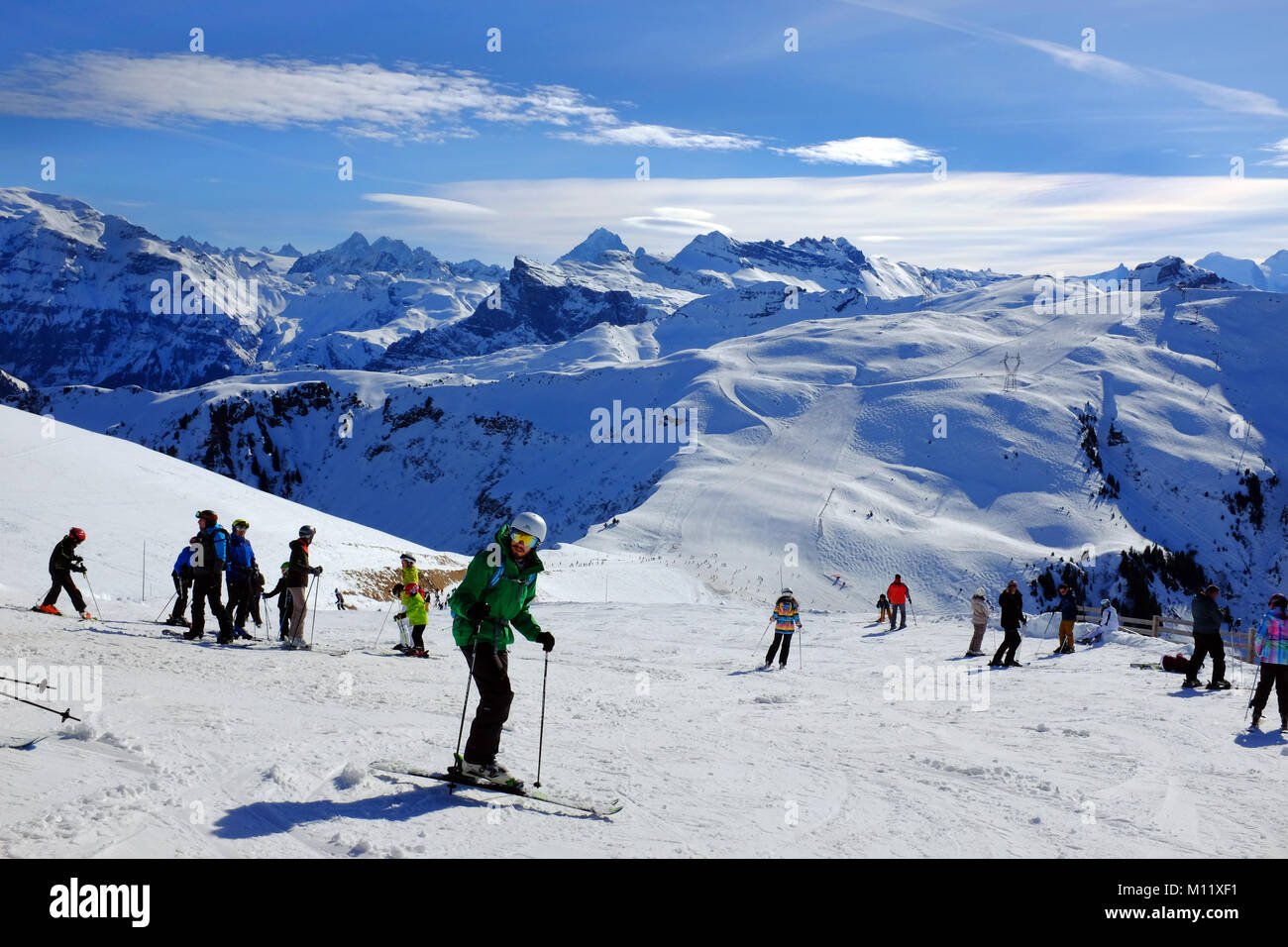 View of Skiers from the chair lift on a Sunny ski piste Samoens France - Stock Image