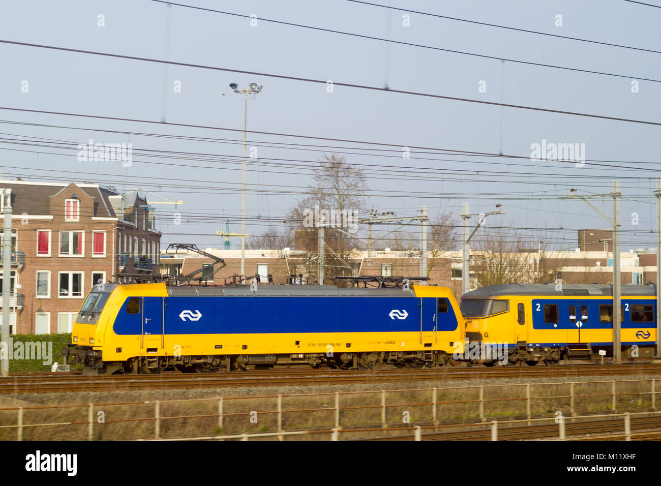 Amsterdam Centraal Station, the Netherlands - 28 March 2017: Dutch electric intercity direct train departing Amsterdam - Stock Image