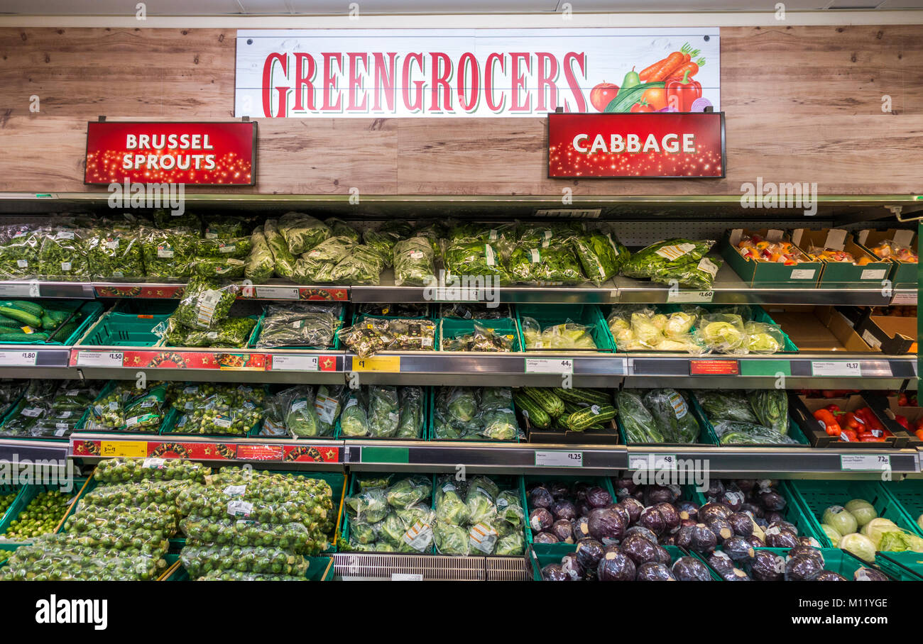 Morrisons supermarket. The greengrocers display area, with a variety of vegetables etc on racks. Stamford, Lincolnshire, - Stock Image