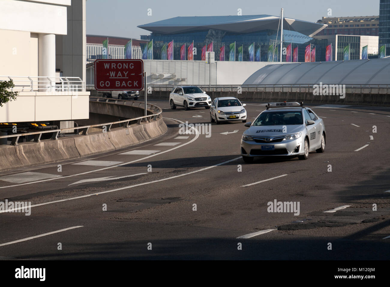 'wrong way go back' sign western distibutor road darling harbour sydney new south wales australia - Stock Image