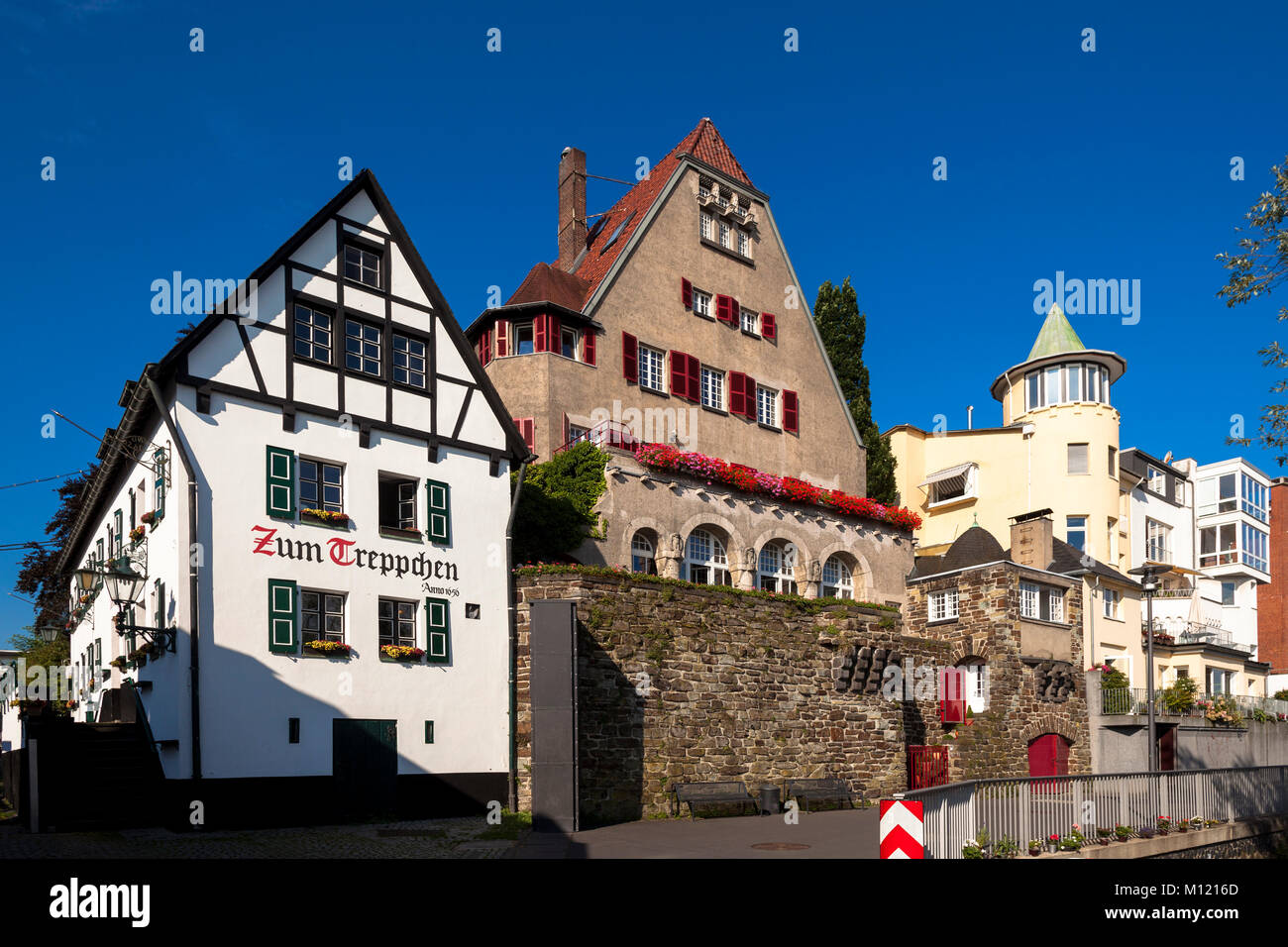 Germany, Cologne, houses at the banks of the river Rhine in the district Rodenkirchen, on the left the traditional - Stock Image