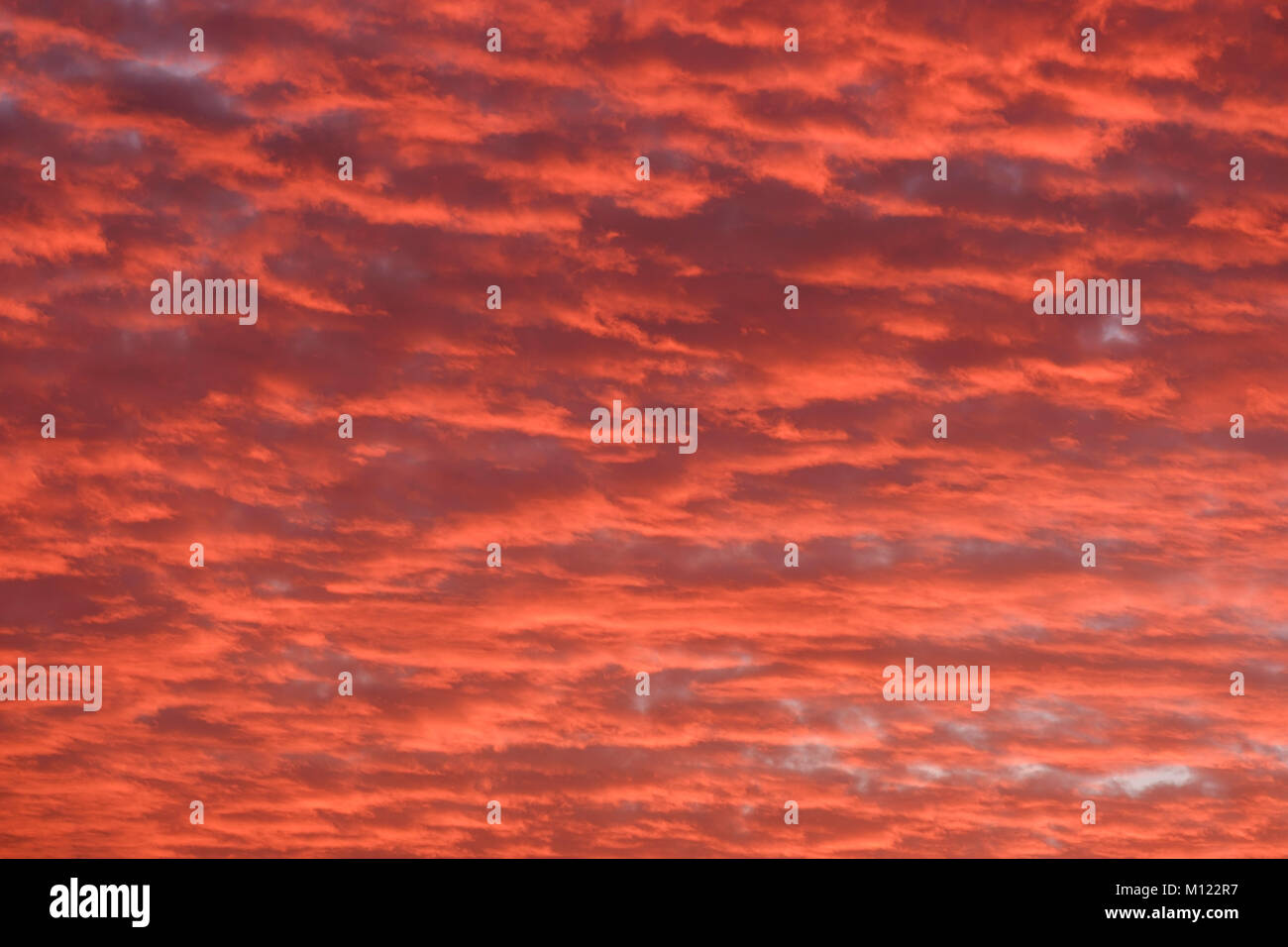 Red cloudy sky at sunset,Atlantic Ocean,La Gomera,Canary Islands,Spain - Stock Image