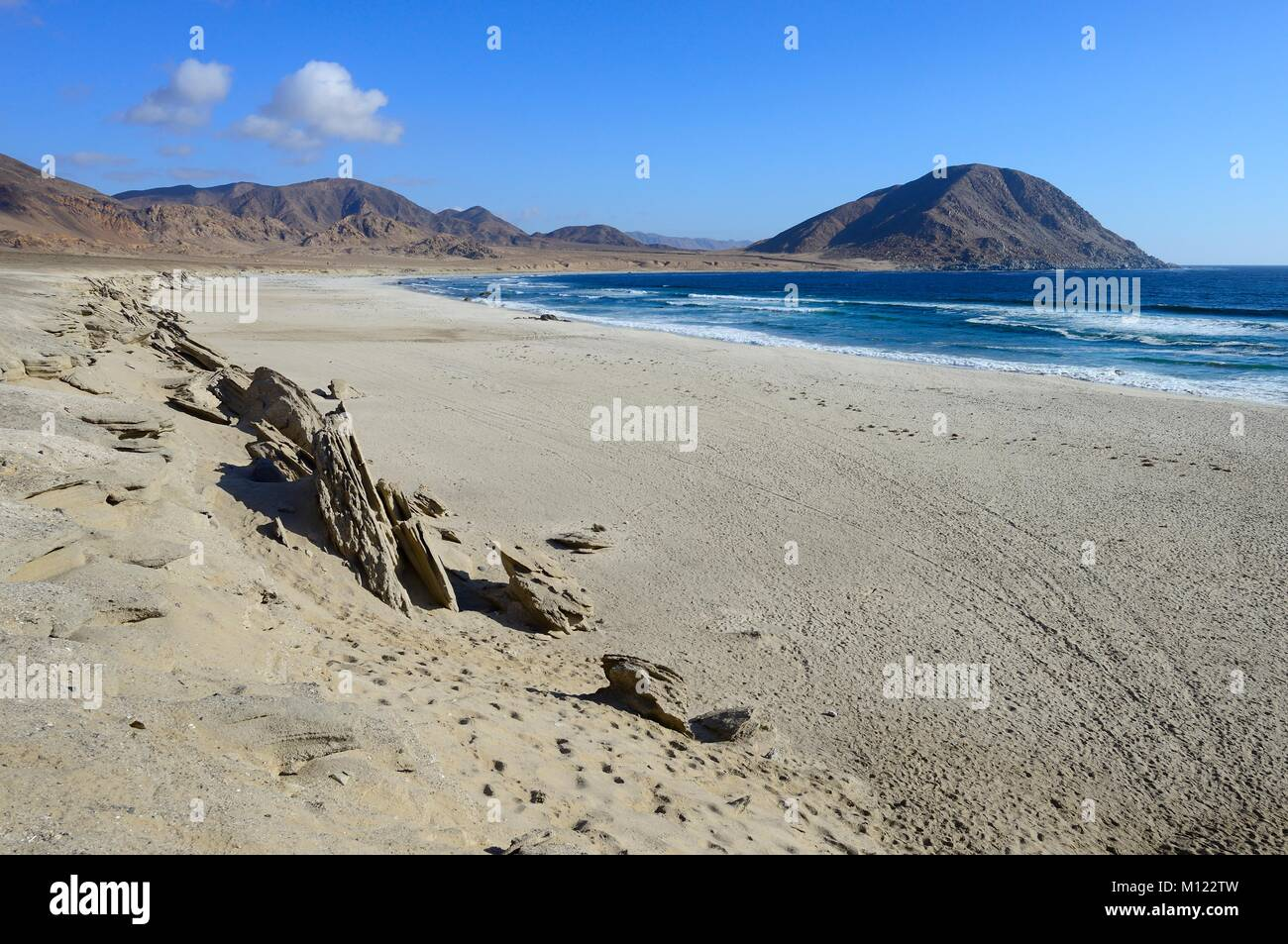 Lonely sandy beach on the Pacific Ocean,Pan de Azúcar National Park,near Chañaral,Región de Atacama,Chile - Stock Image