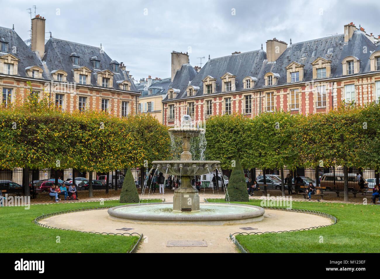 Fountain,Place des Vosges,Paris,France - Stock Image