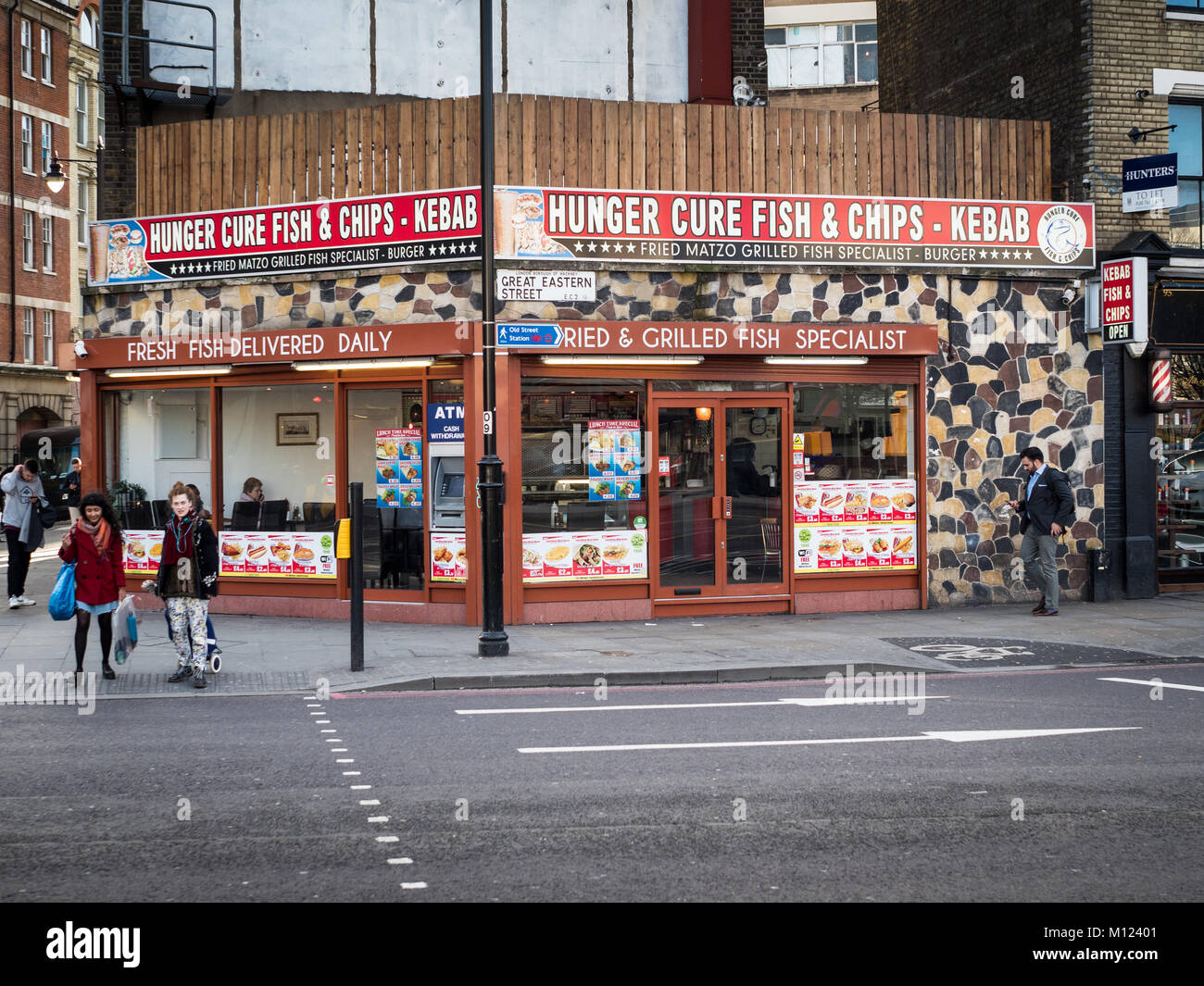Fish & Chips Kebab shop - the Hunger Cure Fish and Chips Kebab shop near Old Street roundabout in Shoreditch, - Stock Image