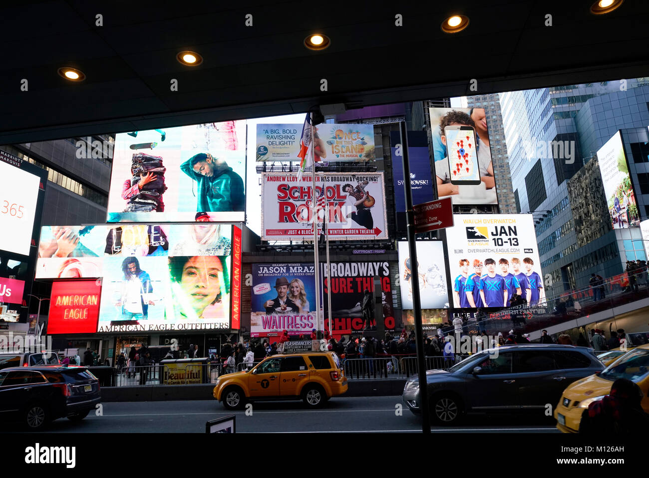 Electronic billboards and traffics in Times Square in a winter day.Manhattan.New York City.USA - Stock Image