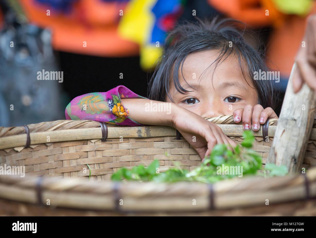bangladeshi girl at a market - Stock Image