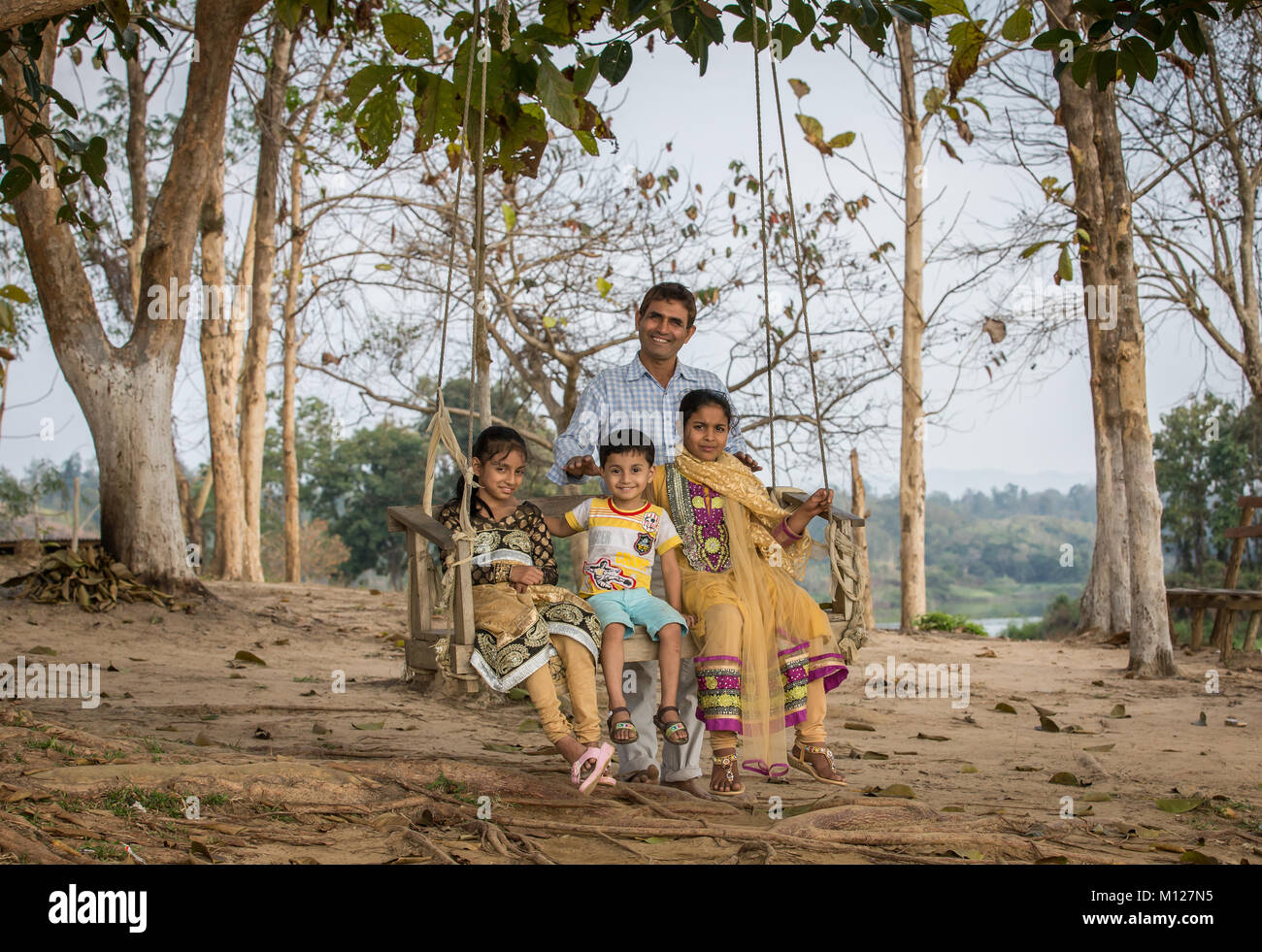 Bangladeshi family on a swing - Stock Image