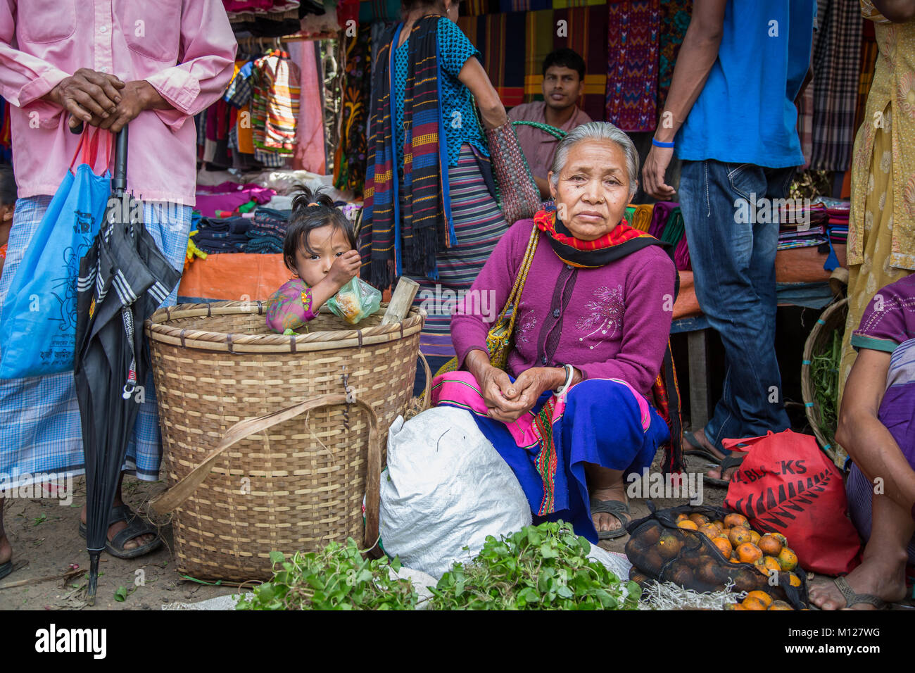 bangladeshi lady at a market selling vegetables - Stock Image