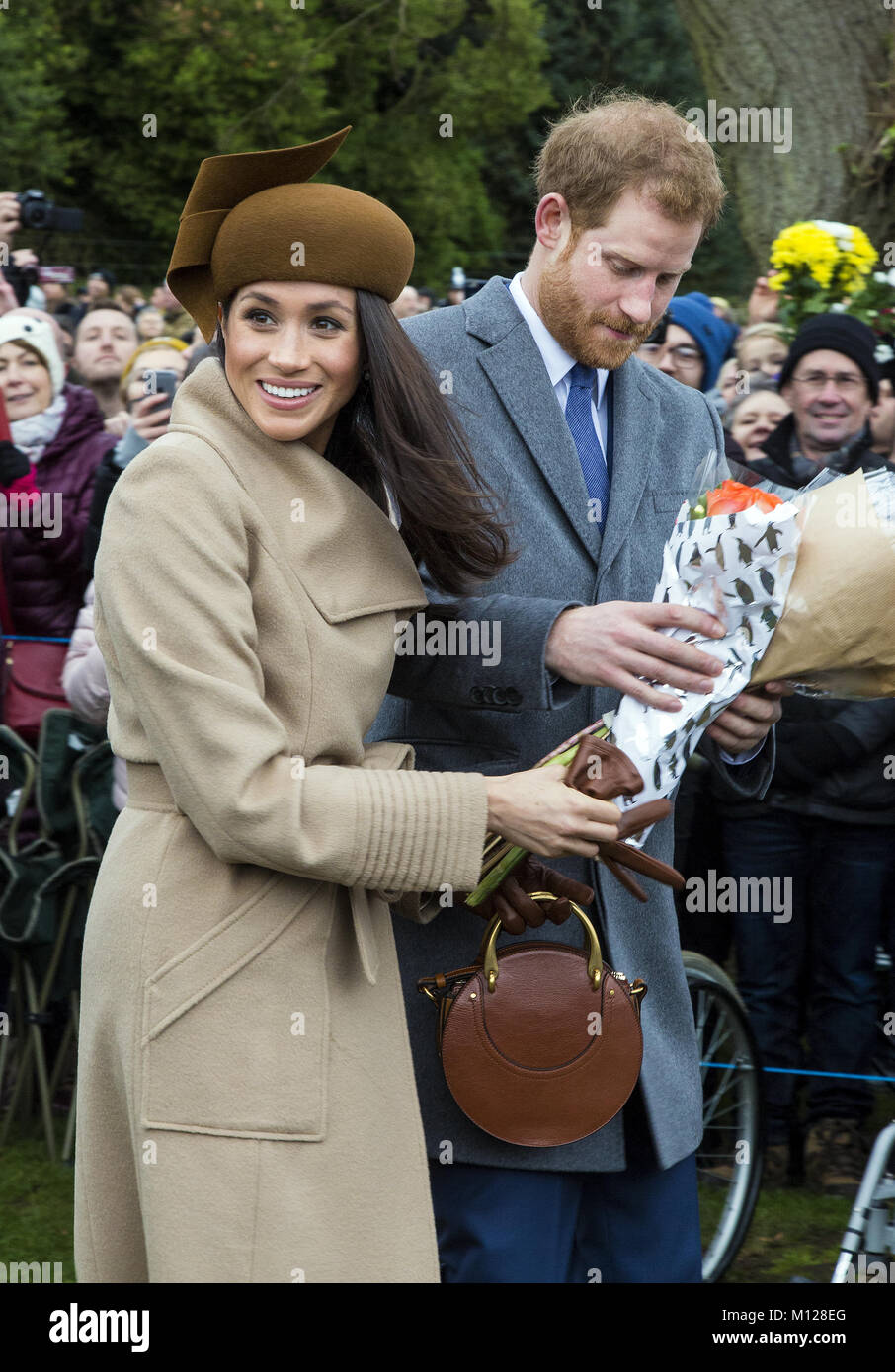 The British Royal family arrive at Sandringham to celebrate Christmas Day  Featuring: Prince Harry, Meghan Markle - Stock Image