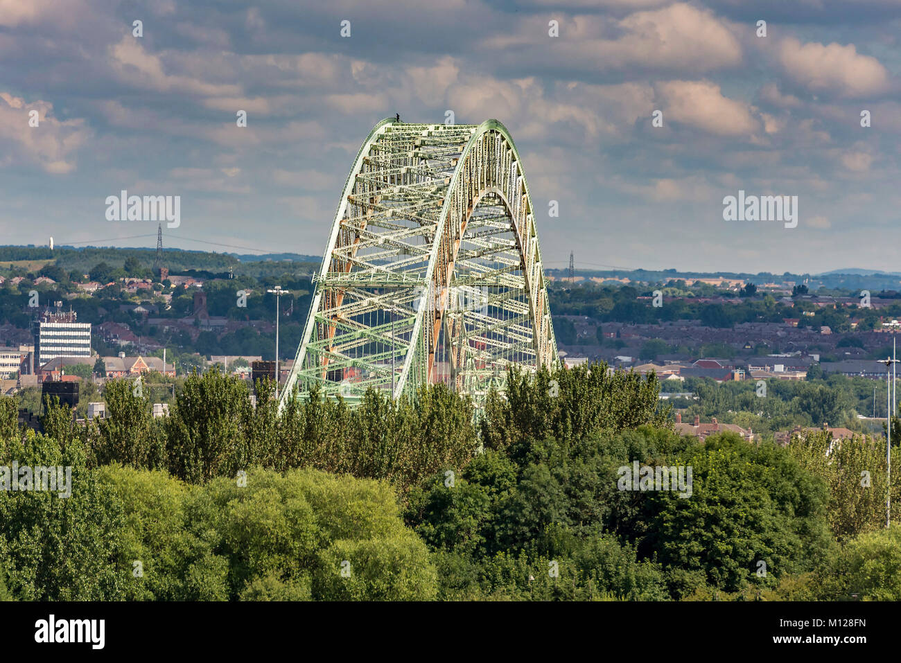 Queensway bridge Runcorn with a man standing on top of the arch. - Stock Image