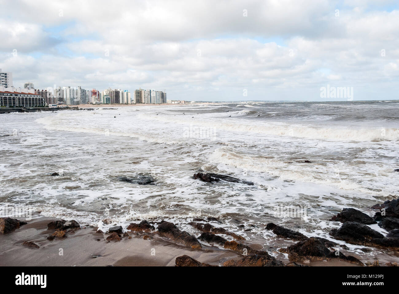 Punta del este view from the beach. The sea was choppy. - Stock Image