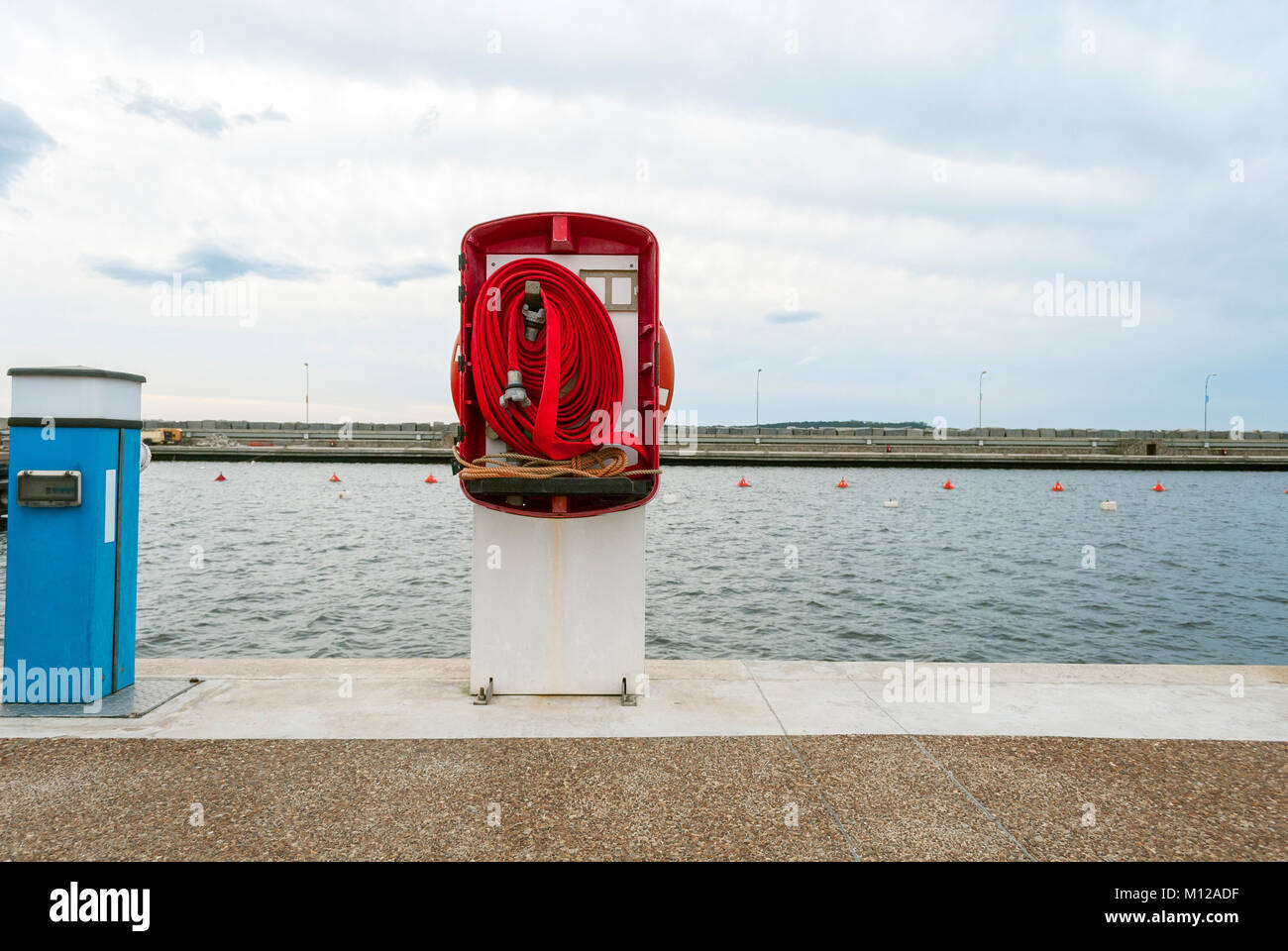 Firehose at Punta del este Port on cloudy day - Stock Image