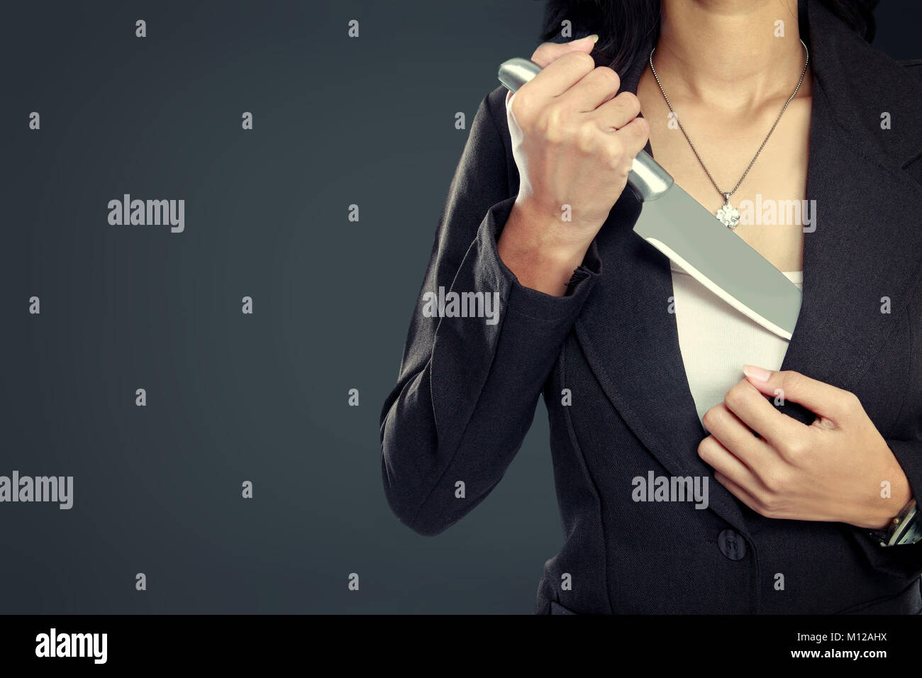 portrait of Business woman pull out his Knife. ready to attack Stock Photo