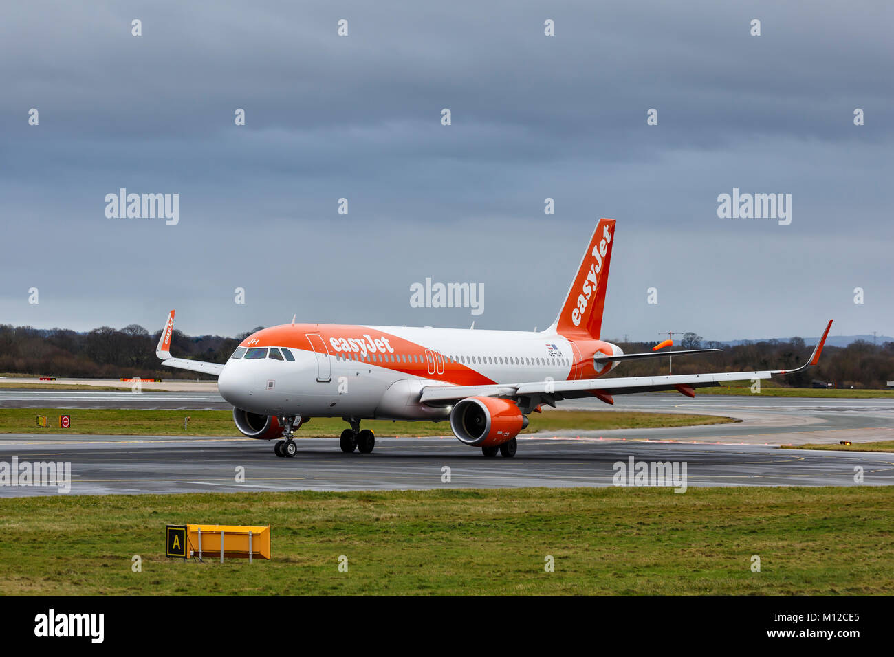 Airbus A320-214, registration OE-IJH, operated by EasyJet, taxiing in foggy conditions at Manchester International - Stock Image