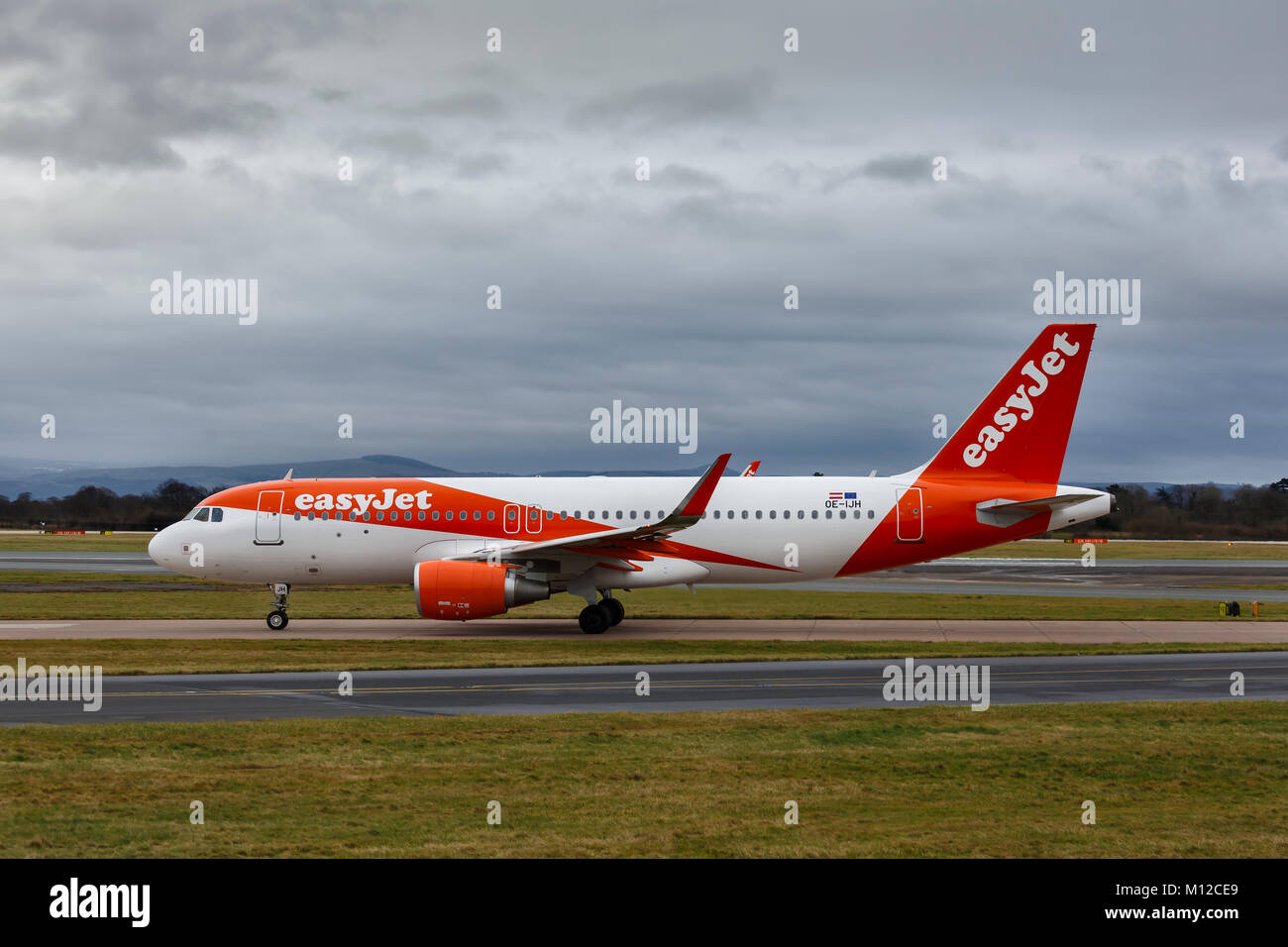 Airbus A320-214, registration OE-IJH, operated by EasyJet, taxiing in foggy conditions at Manchester International Stock Photo