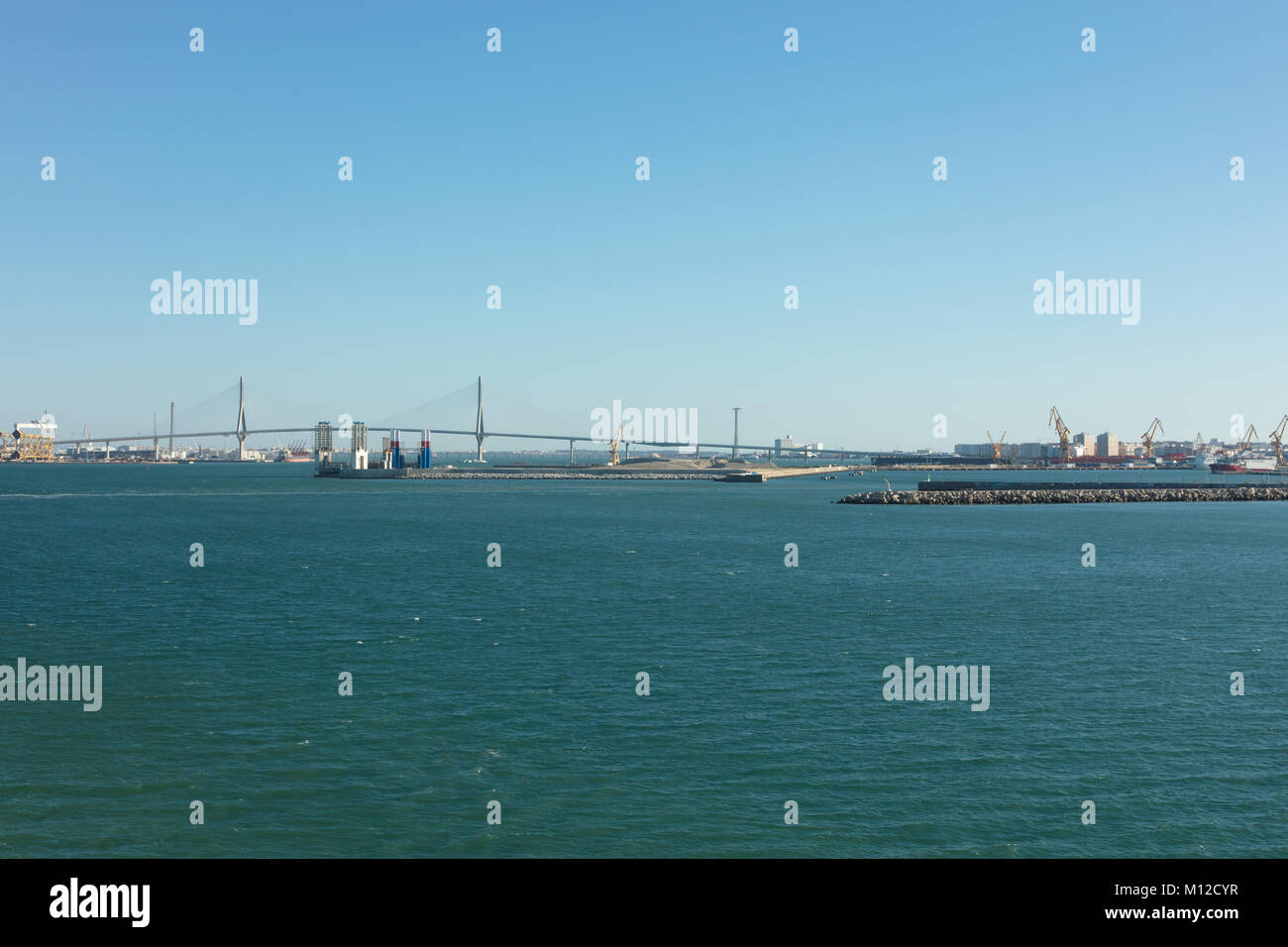 The long breakwater and bridge at the entrance to Cadiz harbour Spain - Stock Image