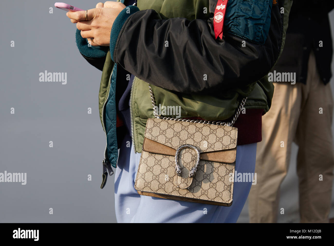 facb4d7c79482 MILAN - JANUARY 14  Woman with Gucci bag and green and black bomber jacket  before Dsquared 2 fashion show