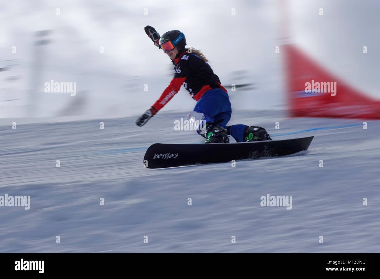 Snowboard Giant Slalom Competition.  Female competitor. Motion blur. Rogla ski resort, Slovenia. - Stock Image