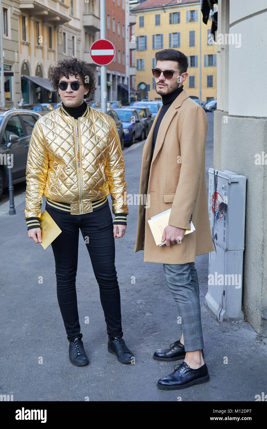 Milan January 14 Men With Golden Bomber Jacket And Beige Coat