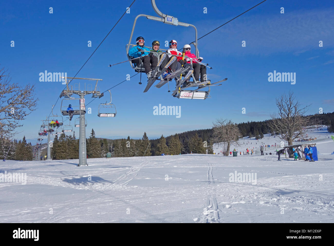 People riding the chair lift. Rogla ski resort, Pohorje, Slovenia. - Stock Image