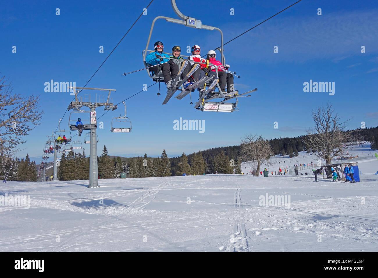 People riding the chair lift. Rogla ski resort, Pohorje, Slovenia. - Stock Image