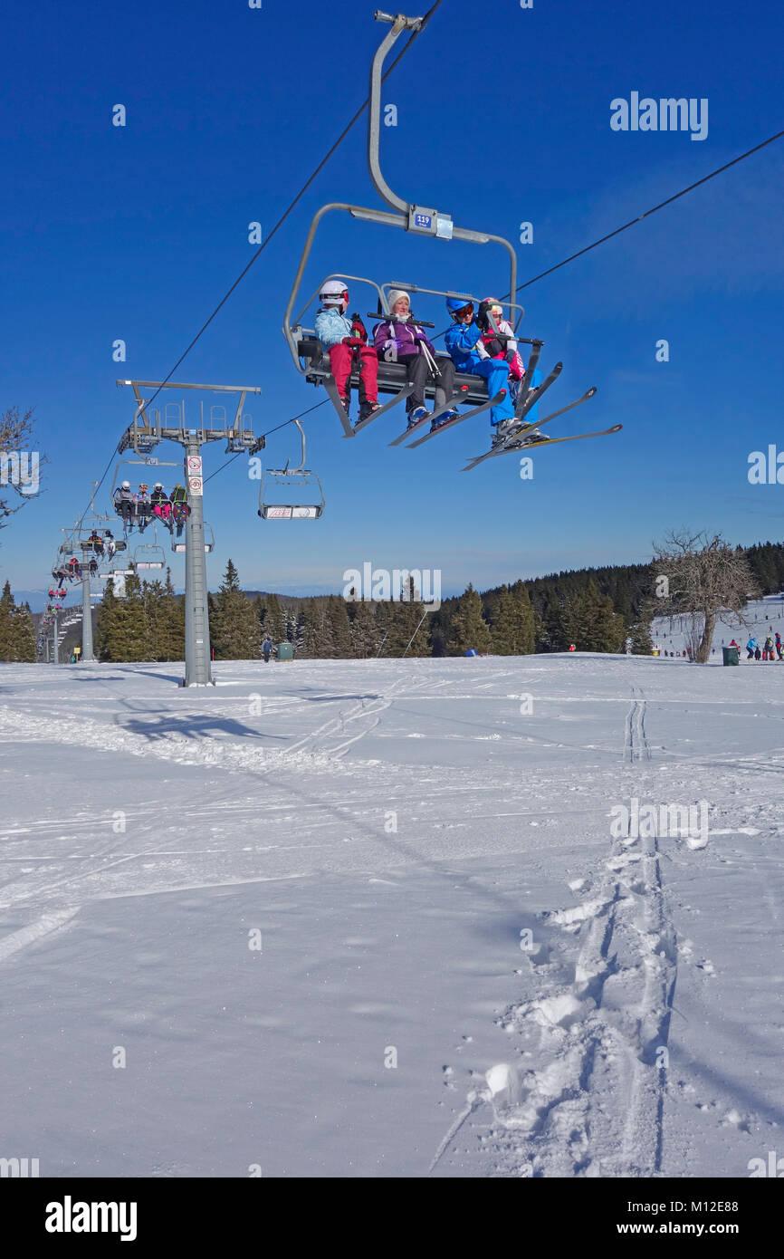 People Riding The Chair Lift. Rogla Ski Resort, Pohorje, Slovenia.