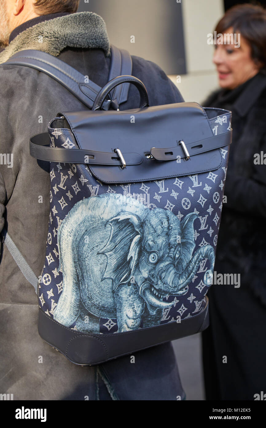 0f46a4f65e25 MILAN - JANUARY 14  Man with blue leather Louis Vuitton backpack with  elephant before Daks fashion show