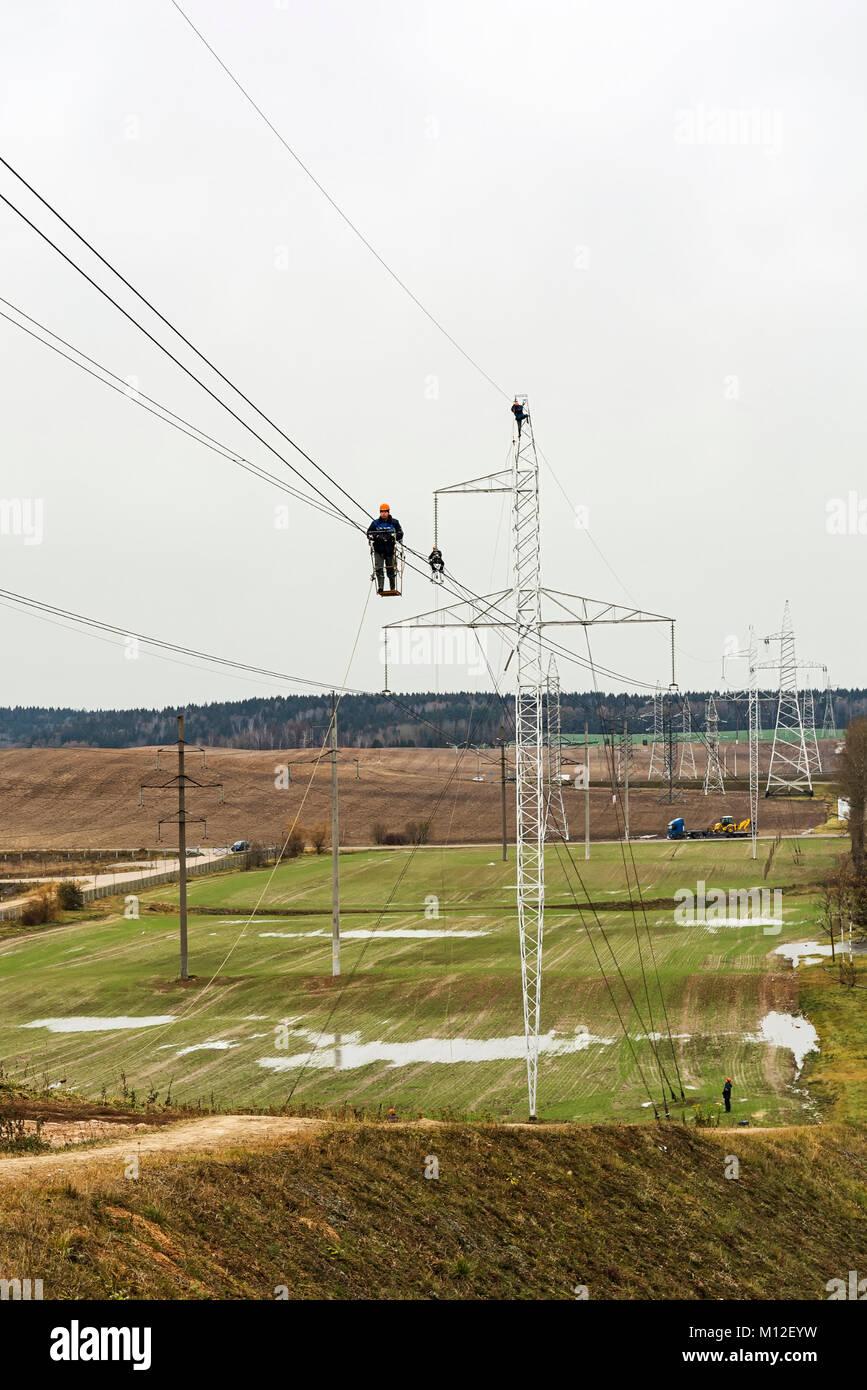 Belarus, Minsk – 09 Nov 2016: Workers inspect the wires of high voltage transmission lines - Stock Image