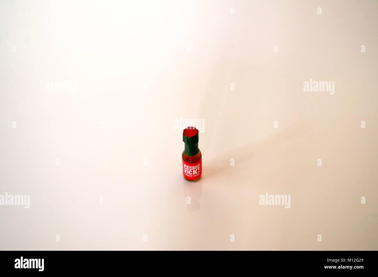 Small bottle of sauce isolated on white background - Stock Image