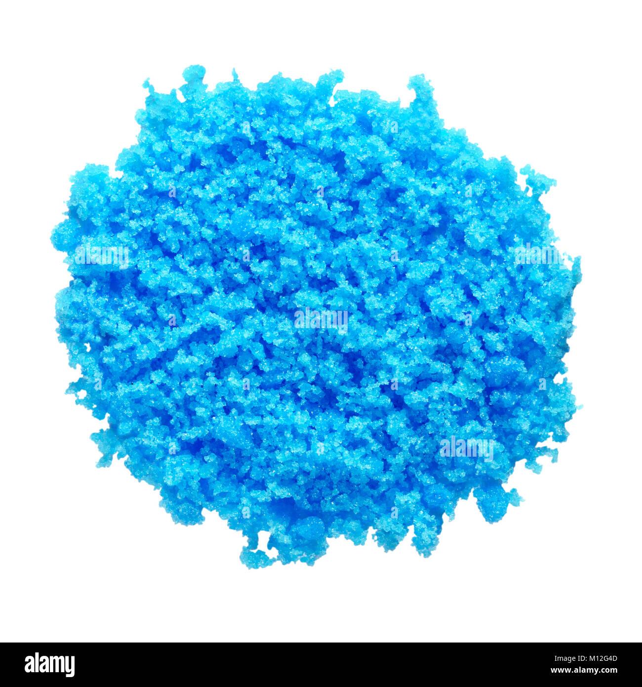 Cupric sulfate isolated on white. Bright, blue copper sulfate, CuSO4, also called blue vitriol or bluestone. Salt. - Stock Image