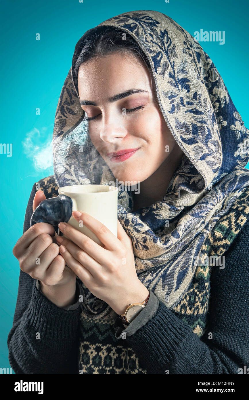 Sweet smell of her favorite hot drink - Stock Image