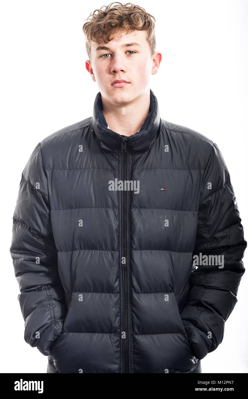 great deals 2017 excellent quality entire collection A 14 year old boy wearing a coat in the studio Stock Photo ...