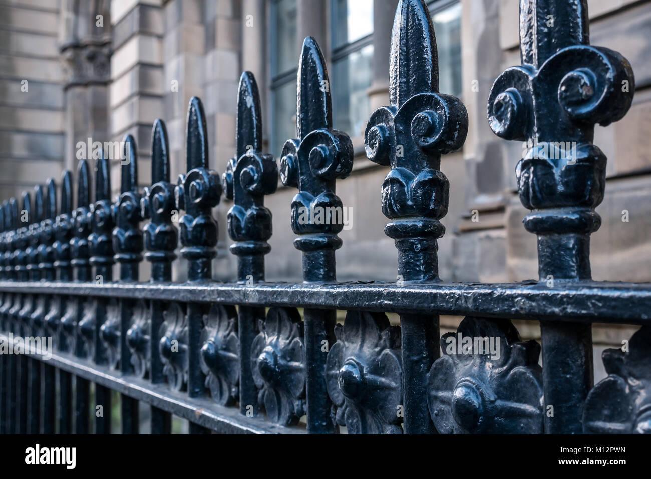 Close up of Victorian black cast iron railings with fleur de lys pattern, Chambers Street, Edinburgh, Scotland, - Stock Image