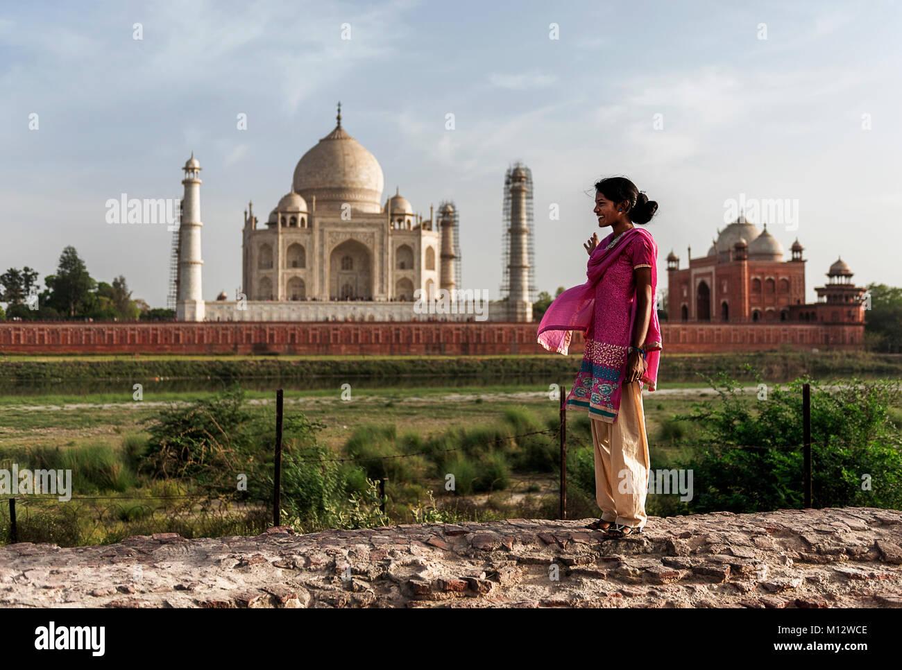 Local woman cheerfully enjoying the amazing view of Taj Mahal, Agra, India. - Stock Image