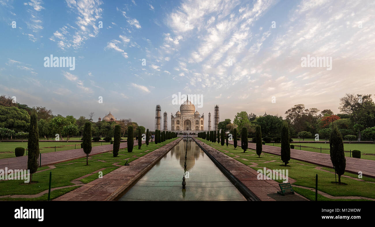 Beautiful reflection of Taj Mahal early in the morning after sunrise, Agra, India - Stock Image