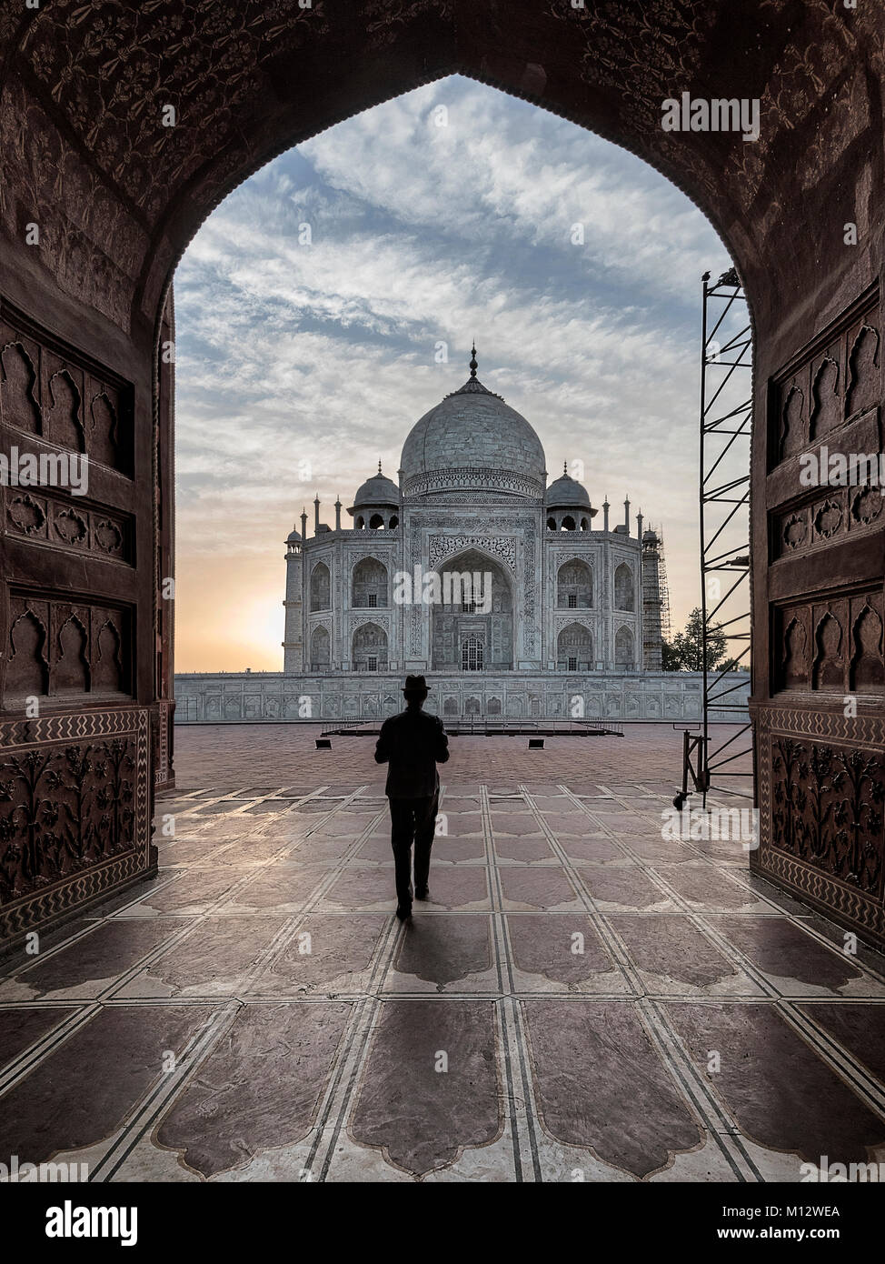 Tourist waking out of the prayer tomb to visit other spots inside Taj Mahal, Agra, India - Stock Image
