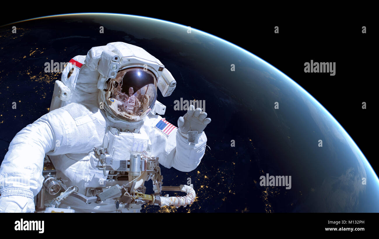 Astronaut in outer space, earth in the background - Nasa images were used for this photo collage - Stock Image