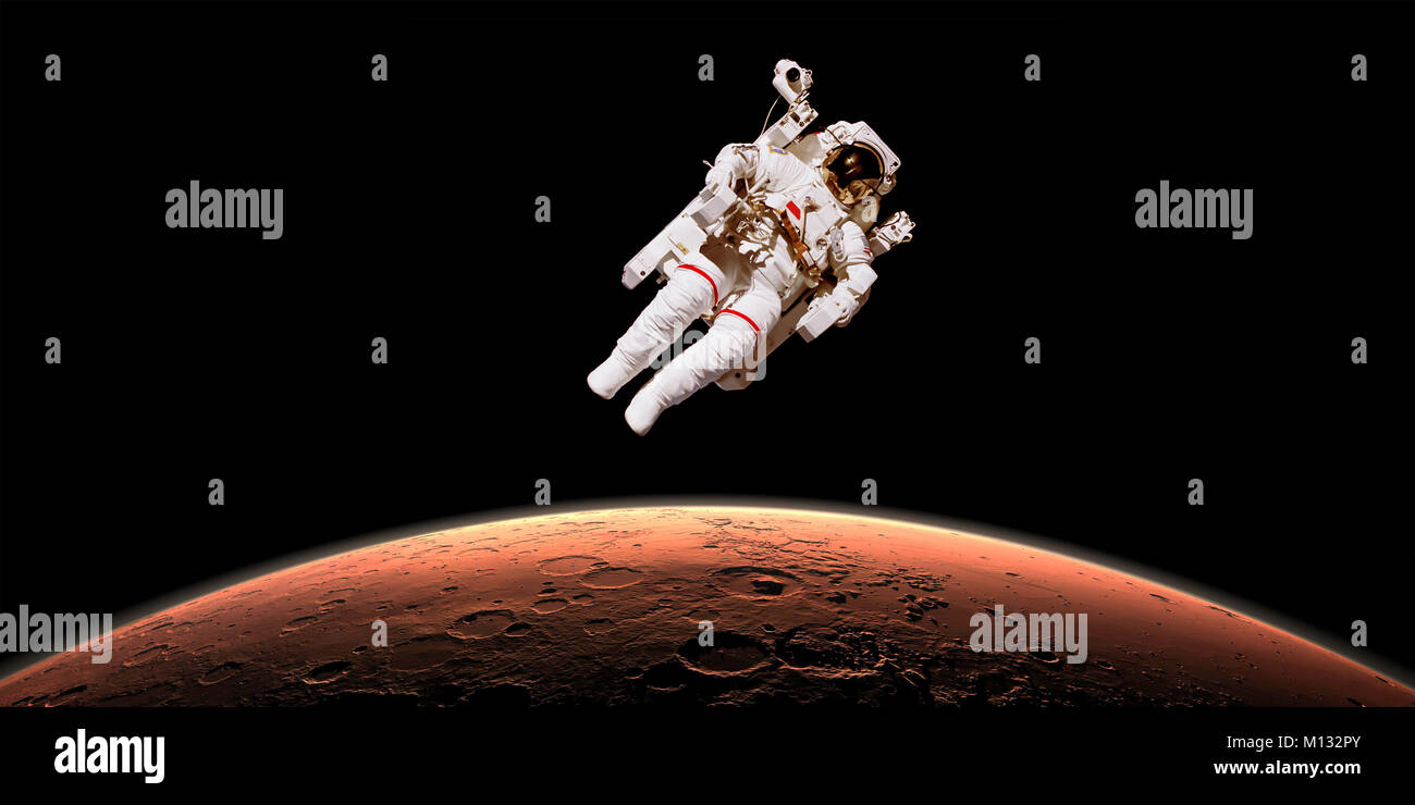 Astronaut in outer space over planet Mars. Elements of the image are furnished by NASA Stock Photo