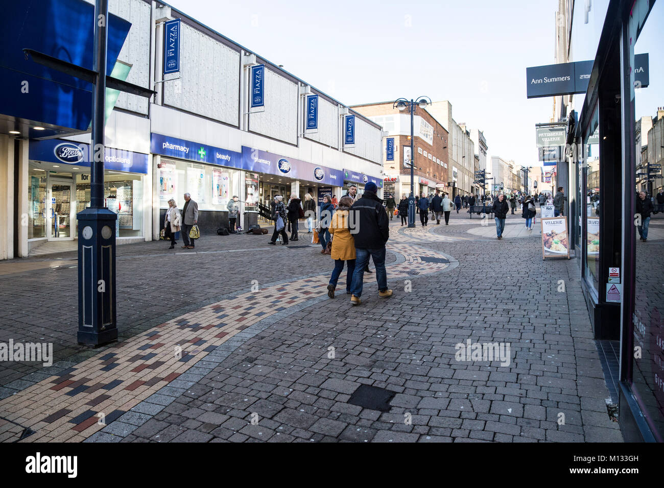 Shoppers in King Street, Huddersfield Town Centre, Kirklees - Stock Image