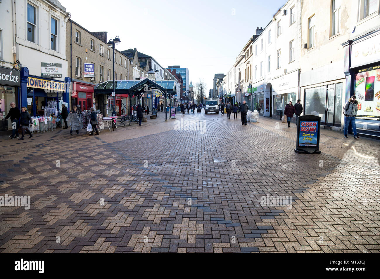 Shoppers in New Street, Huddersfield Town centre, Kirklees - Stock Image