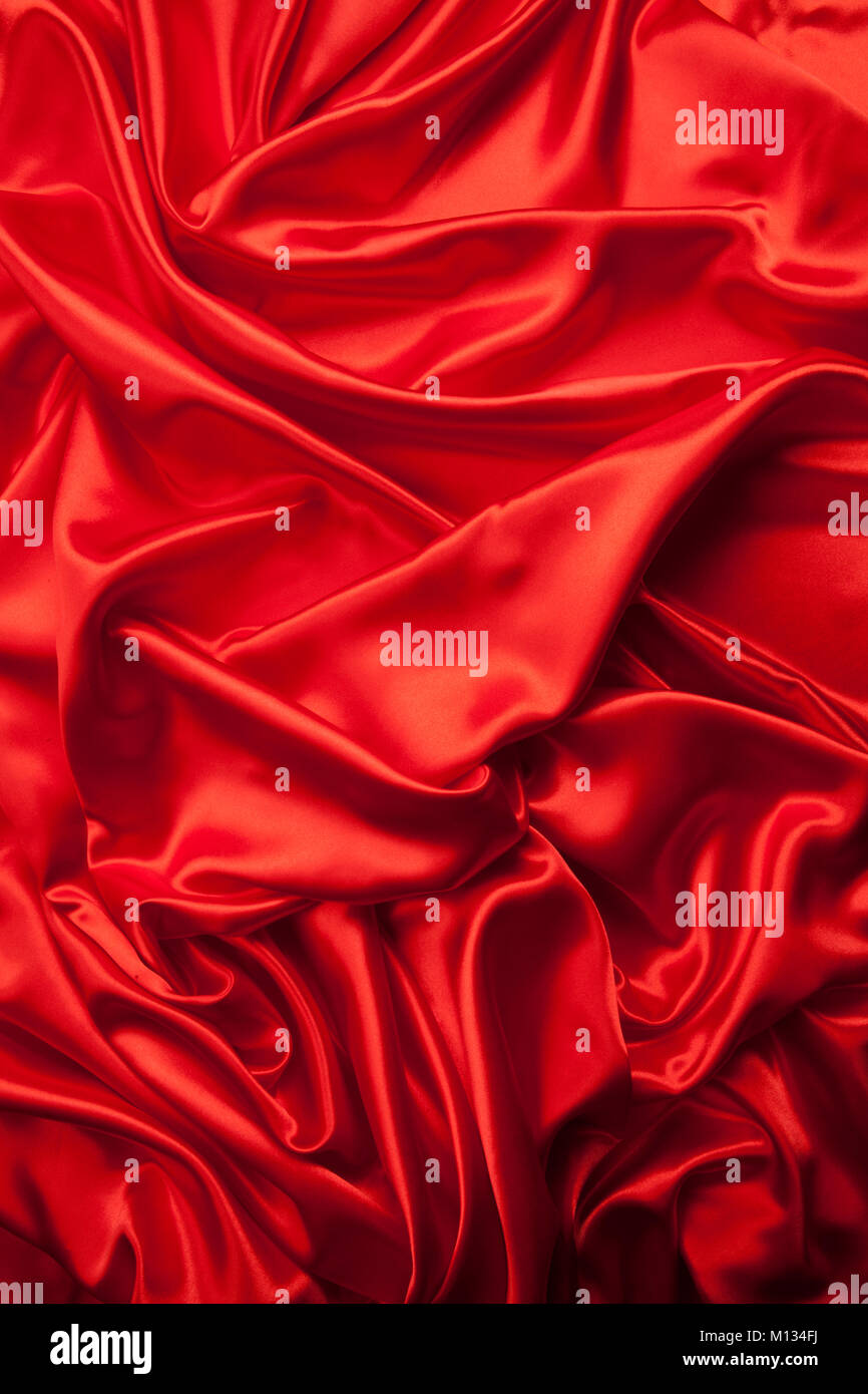 4ab1c7cf1461 close-up view of a red piece of satin fabric. Minimal color still life