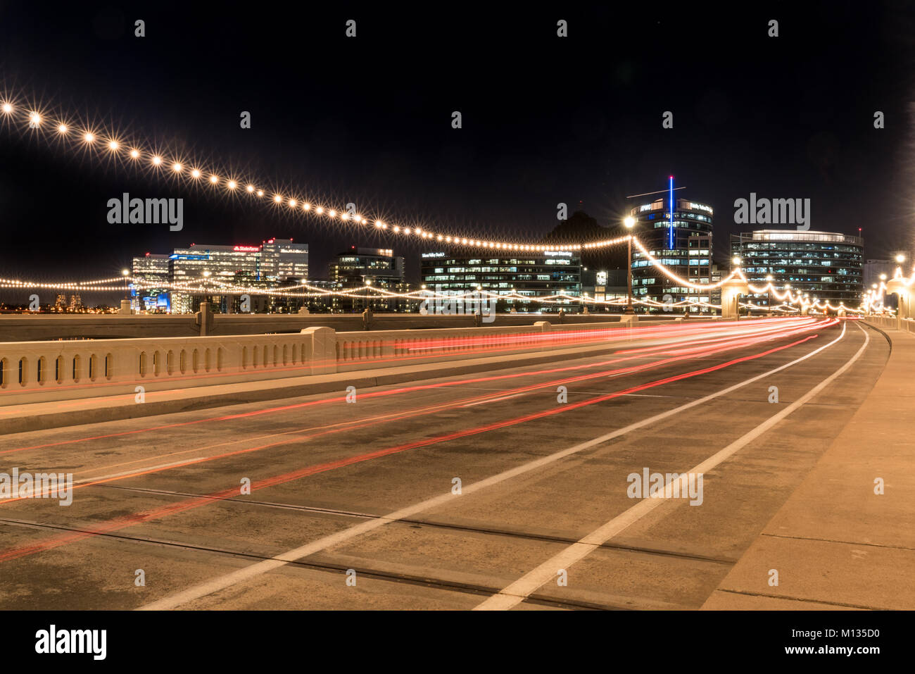 TEMPE, AZ - OCTOBER 25, 2017: The city skyline of Tempe, Arizona at night from the Mill Avenue Bridge across the - Stock Image