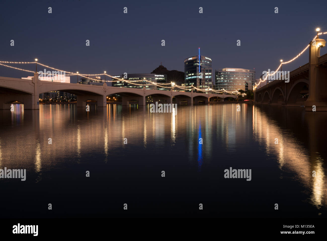 TEMPE, AZ - OCTOBER 25, 2017: The city skyline of Tempe, Arizona at night from across the Salt River at Tempe Town - Stock Image