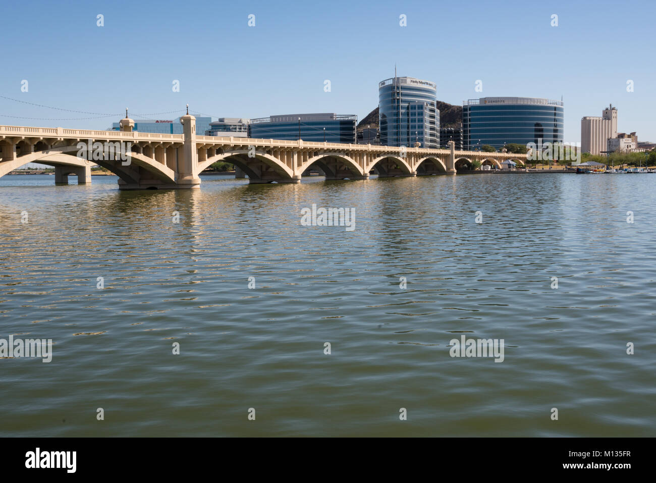 TEMPE, AZ - OCTOBER 25, 2017: The city skyline of Tempe, AZ from across the Salt River at Tempe Town Lake - Stock Image