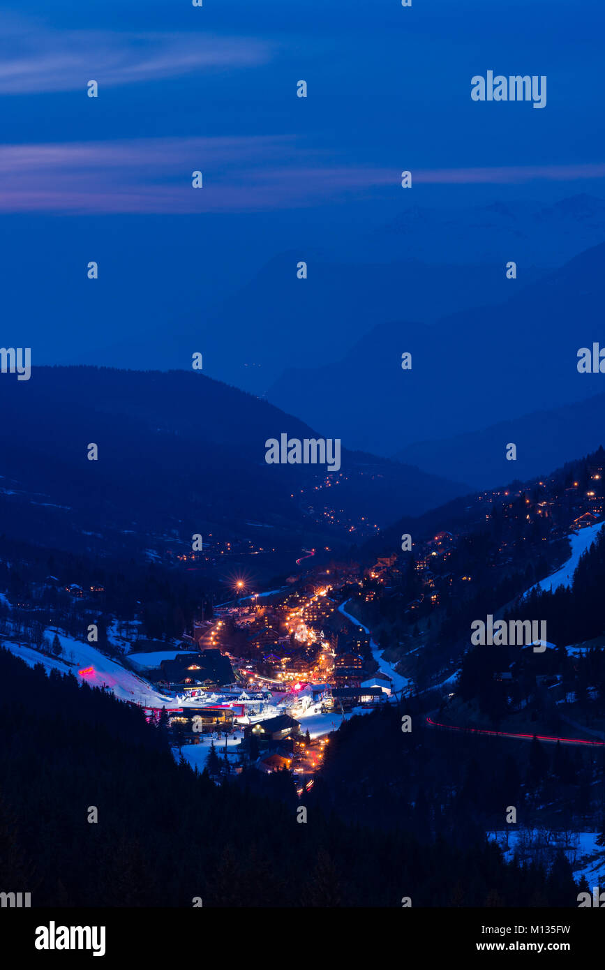 The ski resort town of Meribel and the 3 Valleys mountain area at dusk, France - Stock Image