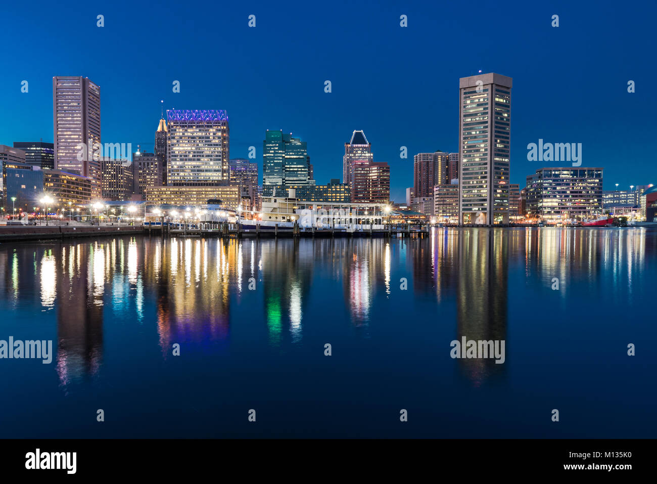 BALTIMORE, MD - DECEMBER 29, 2014: Baltimore night skyline reflection from Inner Harbor Stock Photo